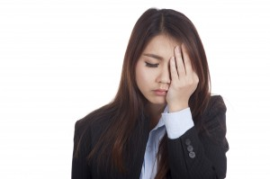 Young Asian businesswoman got headache